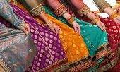 stock photo of belly-band  - Bollywood dancers are holding their vivid costumes - JPG