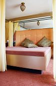 picture of brothel  - Kingsize Bed in a Brothel with some Pillows - JPG