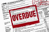 stock photo of delinquency  - Red warning stamp on income tax form - JPG