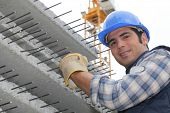 foto of reinforcing  - Construction worker with slabs of reinforced concrete - JPG