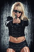 stock photo of projectile  - sexy woman holding up her weapon - JPG