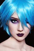 foto of freaky  - Portrait of young beautiful girl in fancy blue wig - JPG