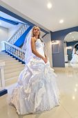 Beautiful young  bride wearied in dress and veil next to mirror