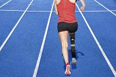 stock photo of amputation  - athlete with handicap on a race track - JPG