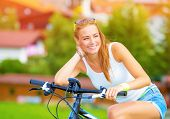 Happy woman traveling on bicycle along Europe, active lifestyle, enjoying riding on pushbike, summer