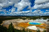 Grand Prismatic Pool at Yellowstone National Park with blue sky and puffy clouds