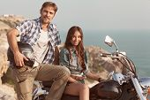 Stylish couple on a motorcycle.