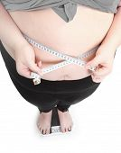 stock photo of diabetes mellitus  - Overweight woman measure her waist belly by metre - JPG