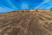 image of granite dome  - The View Climbing Up the Amazing Granite Stone Dome of Legendary Enchanted Rock - JPG