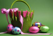 image of bunny ears  - Happy Easter Easter egg hunt with colorful Spring theme polka dot carry basket bag and chocolate Easter eggs on green background - JPG