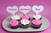 Happy Mother's Day Message Across White Heart Toppers On Pink And White Decorated Red Velvet Cupcake