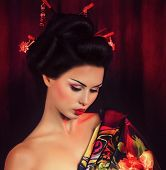 image of yellow orchid  - Portrait of a Japanese geisha woman   - JPG