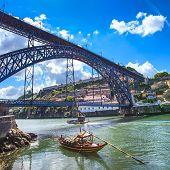 picture of dom  - Oporto or Porto city skyline Douro river traditional boats and Dom Luis or Luiz iron bridge - JPG