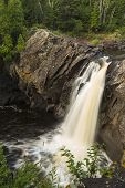 stock photo of baptism  - A waterfall on the Baptism River in northern Minnesota - JPG