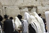 stock photo of israel people  - group of people prays at the western wall in Jerusalem - JPG