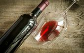 stock photo of bordeaux  - Wine glass and bottle with red wine - JPG