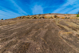 foto of granite dome  - The View Climbing Up the Amazing Granite Stone Dome of Legendary Enchanted Rock - JPG