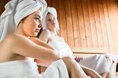 picture of sauna woman  - Two Women in wellness spa relaxing in wooden sauna - JPG