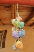 image of rafters  - Colorful clay pots hanging from a rafter by twine - JPG