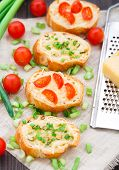 image of scallion  - Delicious bruschetta with cherry tomatoes and scallion - JPG
