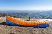 pic of lifting-off  - Paraglider pilot preparing for lift - JPG