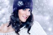 stock photo of ordinary woman  - Beautiful young woman with knitted hat in winter - JPG