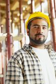 pic of young adult  - Portrait of latin american construction worker looking at camera - JPG