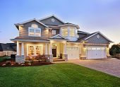 image of garage  - Beautiful exterior of modern new home at sunset - JPG