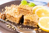 pic of baklava  - Selective focus on the baklava piece on top - JPG