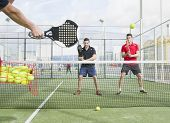 picture of paddling  - Paddle tennis master training with his pupils - JPG