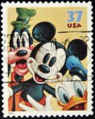 UNITED STATES AMERICA - CIRCA 2004: A stamp printed in USA shows Mickey Mouse Donald Duck and Pluto