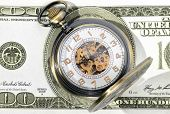 image of two dollar bill  - Macro shot of pocket watch face with 100 dollar bill Ben Franklin - JPG