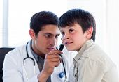Young Doctor Examining Little Boy's Ears