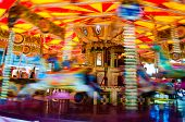 stock photo of carousel horse  - View of Carousel with horses on a carnival Merry Go Round - JPG