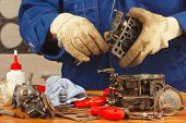 stock photo of carburetor  - Master repairing the old car engine carburetor - JPG