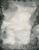 image of saddening  - Black watercolor with soft effect on wet paper - JPG