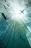 picture of frankfurt am main  - plane flying over a modern glass and steel office building in Frankfurt am Main - JPG