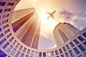 image of frankfurt am main  - plane flying over modern office tower in the sun - JPG