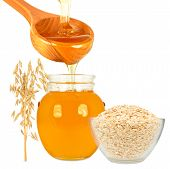 picture of ladle  - honey in jar with ladle and oatmeal on a white background - JPG