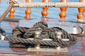 picture of bollard  - Bollards with a mooring rope on a ship. Closeup.