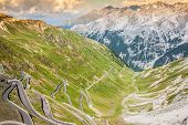 foto of italian alps  - serpentine mountain road in Italian Alps Stelvio pass Passo dello Stelvio Stelvio Natural Park - JPG