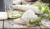 image of grated radish  - Fresh grated Horseradish on wooden background  - JPG