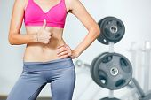 stock photo of six pack  - Closeup of young slim woman with six - JPG