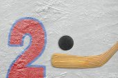image of hockey arena  - Hockey stick puck and the numeral two painted on the ice - JPG