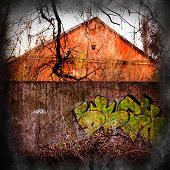 pic of graffiti  - cityscape old house and a concrete fence with a picture of graffiti - JPG