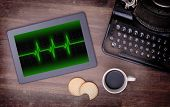 foto of electrocardiogram  - Electrocardiogram on a tablet  - JPG