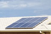 image of roof tile  - Solar photovoltaic panels installed on tiled roof - JPG