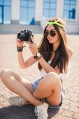 stock photo of denim wear  - Beautiful oriental girl brunette with long straight hair - JPG