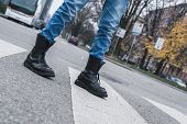 pic of anarchists  - Detail of a punk guy with boots posing in the city streets - JPG