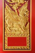 pic of wood craft  - Ancient golden carving wooden window of Thai temple  - JPG